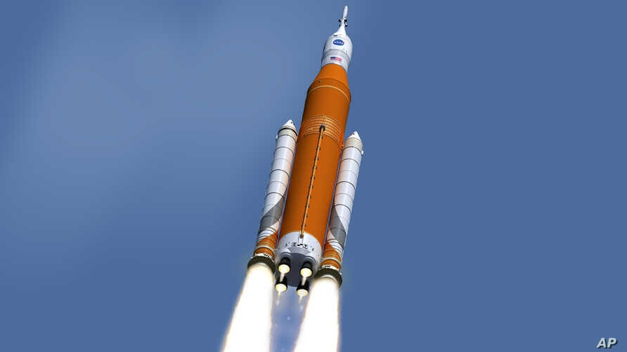 NASA image shows an artist's concept of the launch of the Space Launch System rocket and Orion capsule. On Feb. 24, 2017, NASA said it is weighing the risk of adding astronauts to the first flight of its new megarocket.