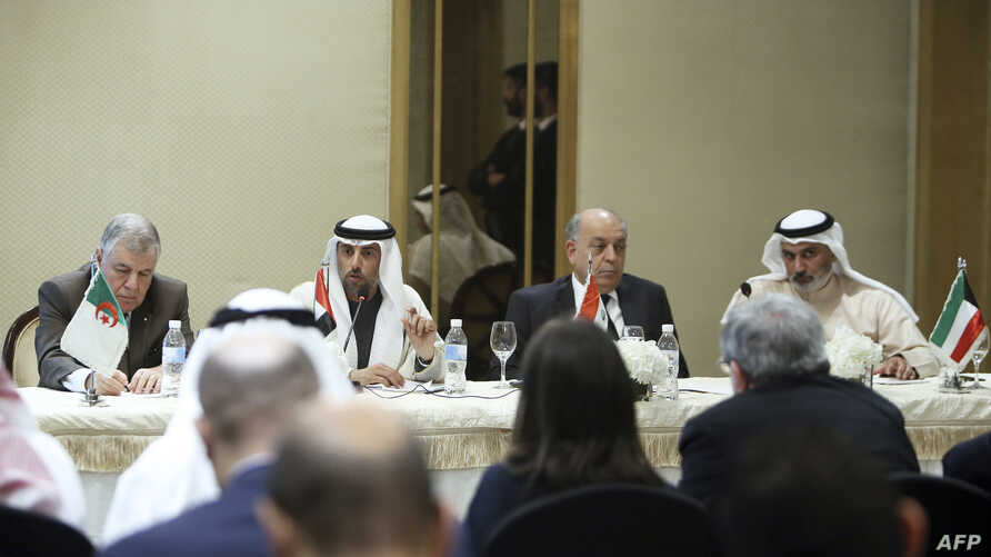UAE minister of energy & industry Suhail al- Mazrouei (2nd-L) speaks during a joint press conference with Iraqi oil minister Thamer Ghadban (2nd-R), Algerian energy minister Mustapha Guitouni (1st-L) and OPEC governor for Kuwait Haitham al-Ghais, at