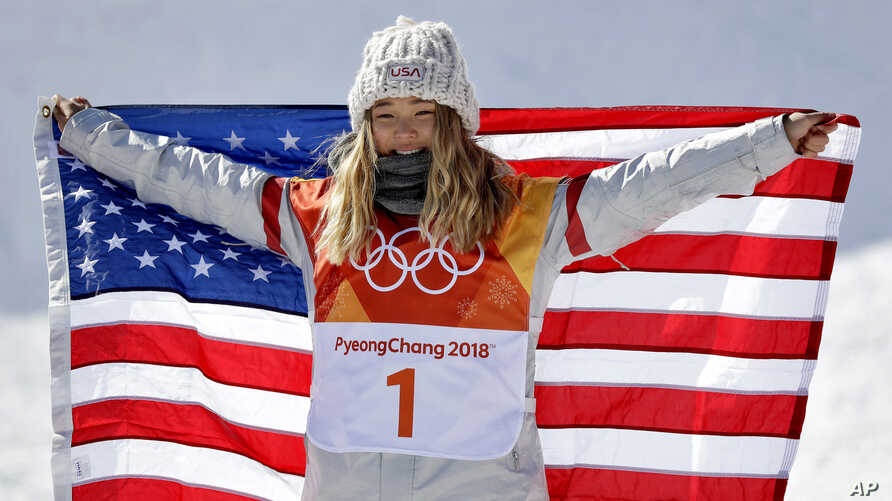 Chloe Kim, of the United States, celebrates winning gold in the women's halfpipe finals at Phoenix Snow Park at the 2018 Winter Olympics in Pyeongchang, South Korea, Feb. 13, 2018.