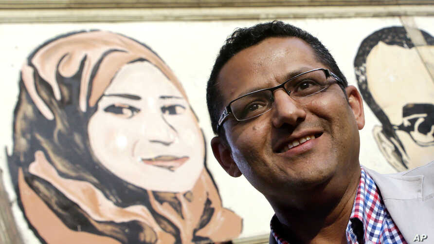 FILE - Khaled El-Balshy, Head of Journalists Syndicate's Freedoms Committee, poses for a photograph in Cairo, Egypt.