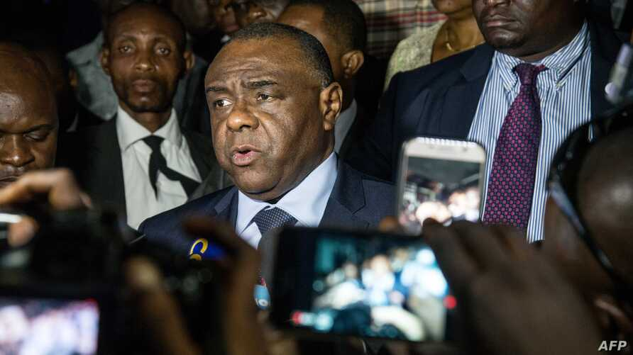 FILE - Former DRC warlord Jean-Pierre Bemba (C), speaks to the press after filing to run as a candidate in the country's next presidential election Dec. 23, at election commission offices, in Kinshasa, DRC, Aug. 02, 2018.