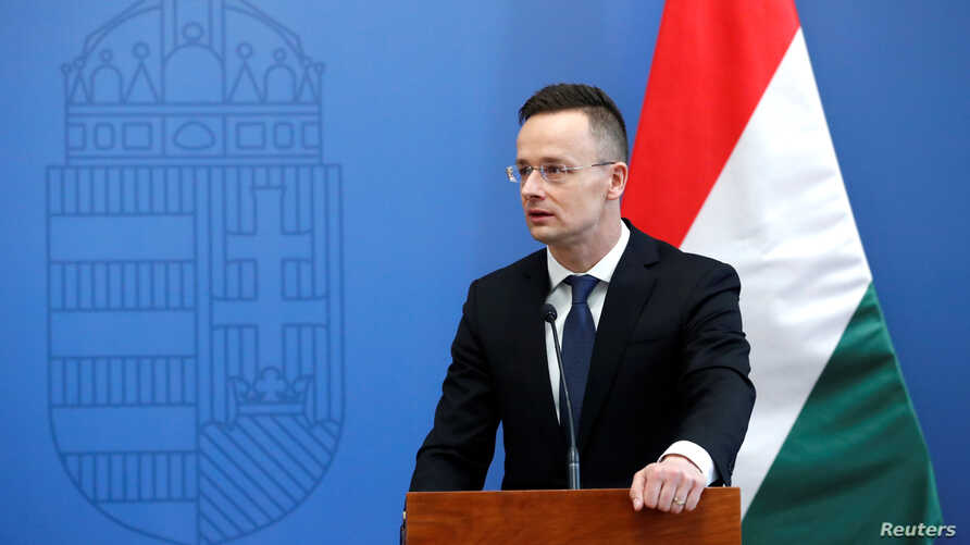 Hungarian Foreign Minister Peter Szijjarto talks during a news conference with Australian Foreign Minister Julie Bishop in Budapest, Hungary, Feb. 22, 2018.