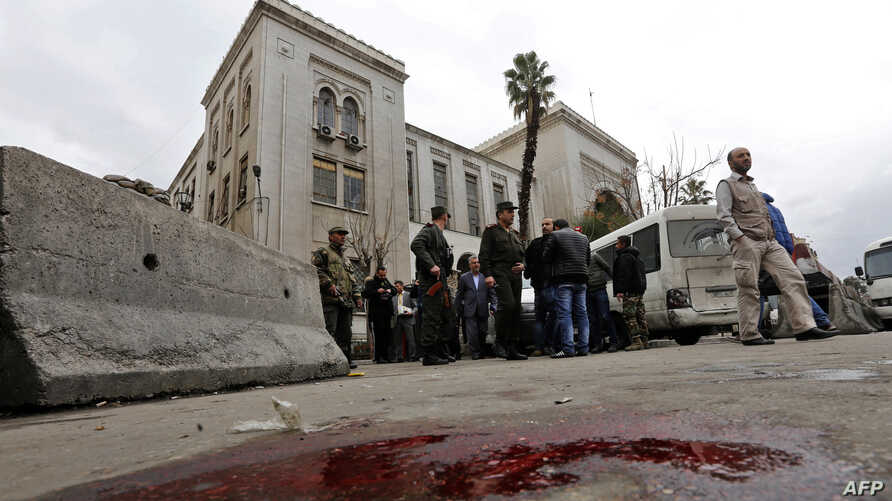Syrian security forces cordon off the area following a reported suicide bombing at the old palace of justice building in Damascus, March 15, 2017.