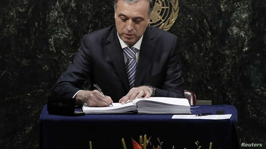 Montenegro President Filip Vujanovic signs the Paris Agreement on climate change at the United Nations Headquarters in New York, April 22, 2016.