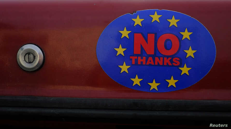 A car sticker with a logo encouraging people to leave the EU is seen on a car, in Llandudno, Wales, February 27, 2016.