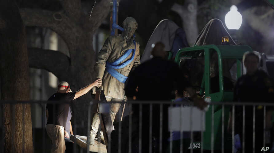 A statue of Confederate Gen. Robert E. Lee is removed from the University of Texas campus, Aug. 21, 2017, in Austin, Texas.