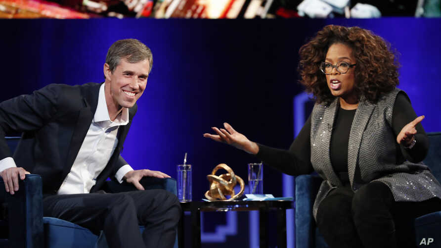 """Former Democratic Texas congressman Beto O'Rourke, left, appears with Oprah Winfrey for """"Oprah's SuperSoul Conversations from Times Square,"""" Feb. 5, 2019, in New York."""