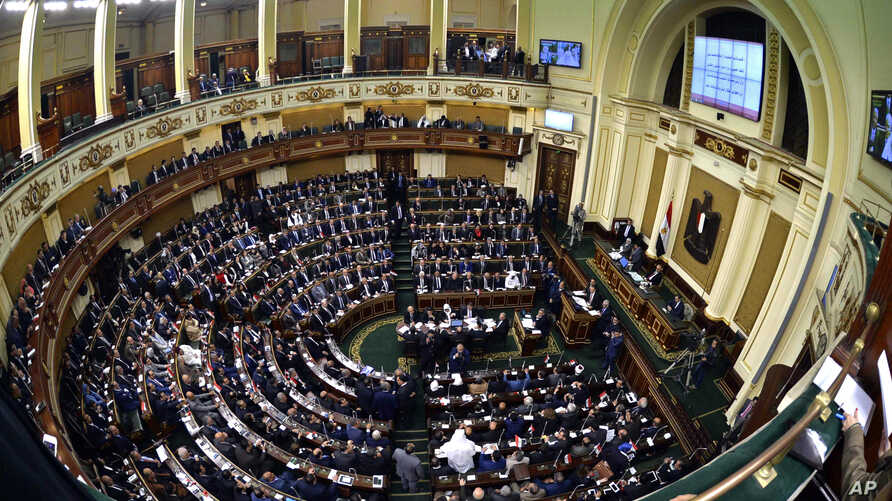 Members of Egypt's Parliament attend the inaugural session, the first to convene in three years, in Cairo, Jan. 10, 2016.