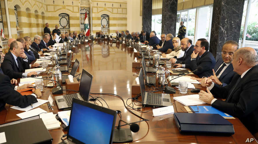 Lebanese ministers attend a Cabinet meeting to approve the new electoral law, at the presidential palace, in Baabda area east of Beirut, Lebanon, June 14, 2017.