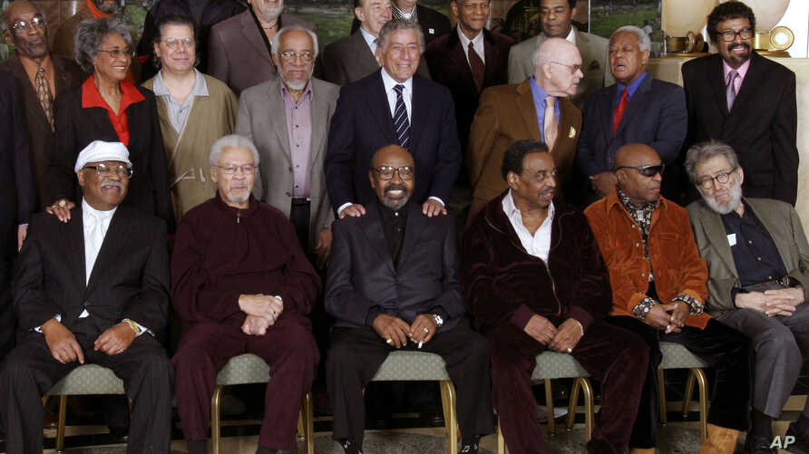 FILE - Jazz legends pose for a group portrait of National Endowment for the Arts Jazz Masters of the past and present, in New York, Jan. 13, 2006. At foreground right is writer Nat Hentoff. His son, Tom Hentoff, said his father died, Jan. 7, 2017, fr