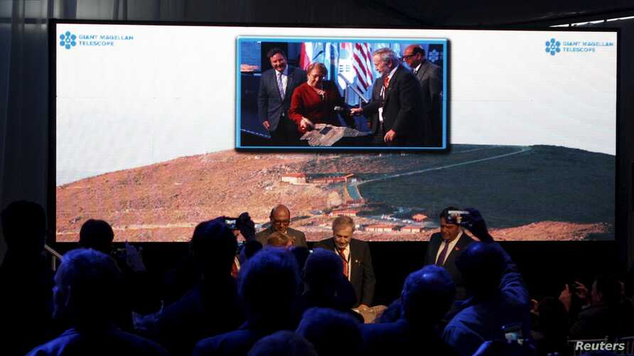 Chile's President Michelle Bachelet (C in the screen) attends the opening ceremony of the construction of The Giant Magellan Telescope (GMT) at Las Campanas hill near Vallenar town, Chile, Nov. 11, 2015.