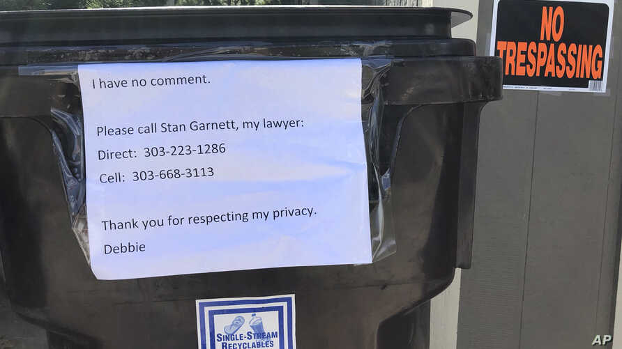 A sign requesting privacy and stating she has no comment is posted outside the home of Deborah Ramirez in Boulder, Colo., Monday Sept. 24, 2018.