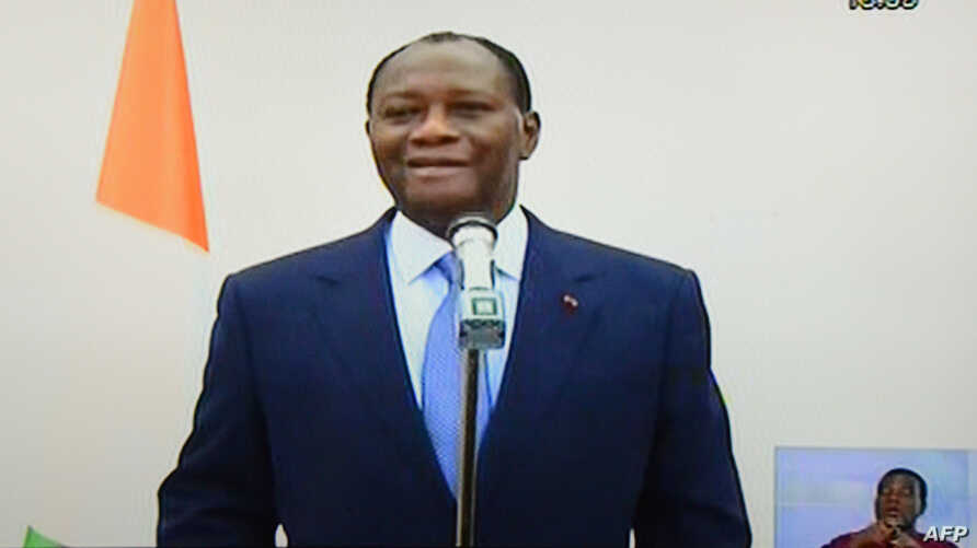 This picture taken on a television screen in Abidjan on Feb. 27, 2014 shows Ivorian president Alassane Ouattara making an announcement during a broadcast by the Ivorian television from Paris.
