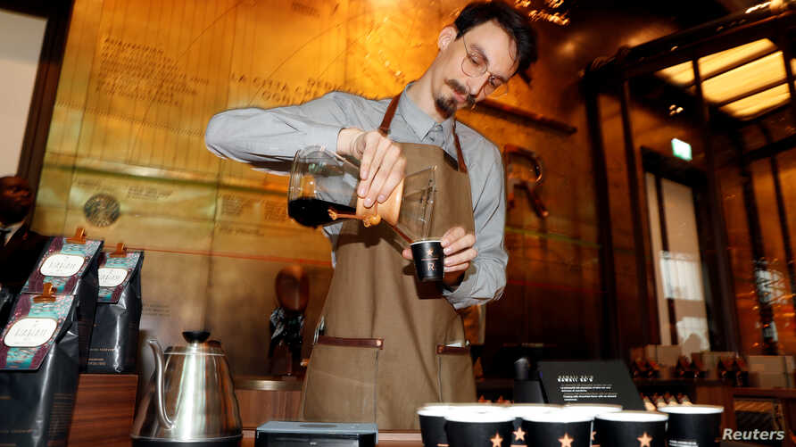 An employee prepares a coffee inside the new Starbucks Reserve Roastery flagship in downtown Milan, Italy, Sept. 4, 2018.