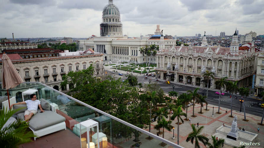 A tourist enjoys a rooftop of a recently renovated Belle Epoque shopping mall housing the Gran Hotel Manzana in the top floors and luxury stores on the ground floor in Havana, Cuba, May 9, 2018.