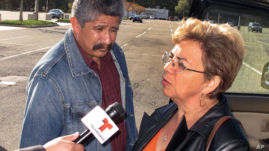 Sandra Zea speaks to reporters outside the U.S. District Courthouse in Central Islip, N.Y., following the arraignment of hers son Marcos Alonzo Zea, Oct. 18, 2013.