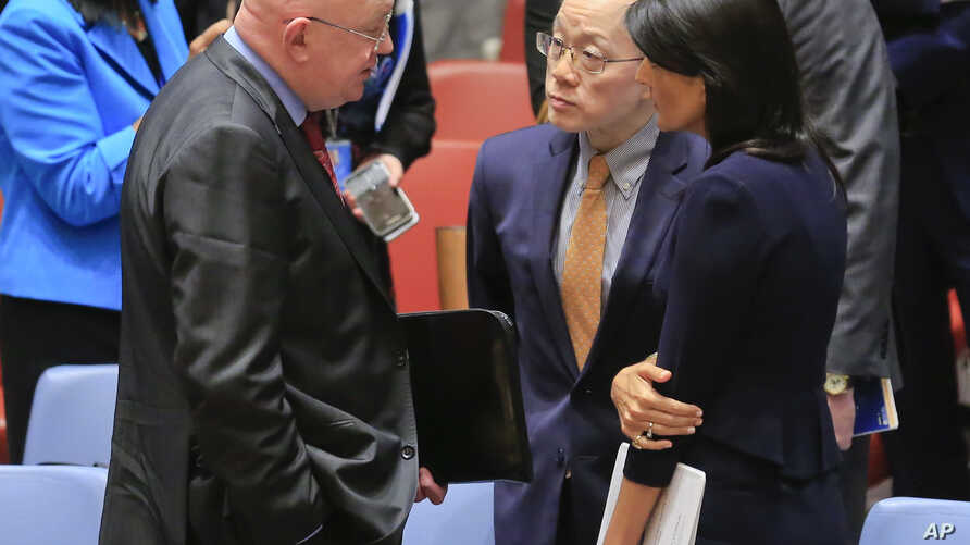 United Nations Ambassadors Vasily Nebenzya of Russia, left, Liu Jieyi of China, center, and Nikki Haley of the U.S., right, confer after the United Nations nonproliferation meeting on North Korea, Sept. 4, 2017 at U.N. headquarters.