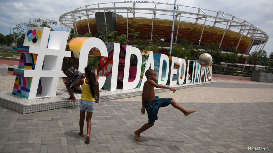 Children play soccer at the Olympic park which was used for the Rio 2016 Olympic Games, in Rio de Janeiro, Brazil, Feb. 5, 2017.