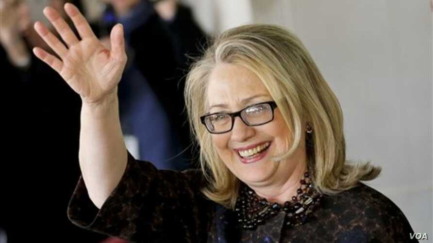 Hillary Rodham Clinton waves as she leaves State Department Feb. 1, 2013