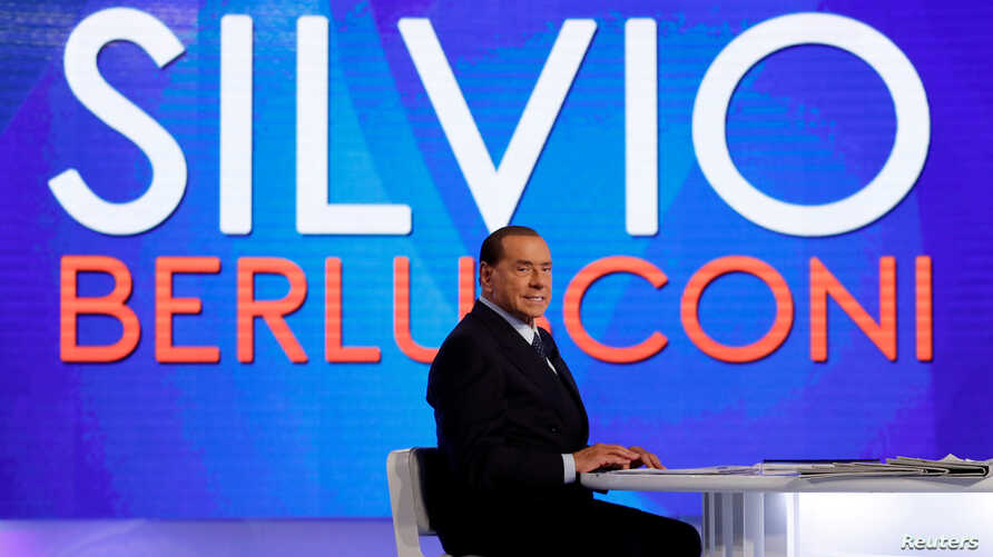 """FILE - Italy's former Prime Minister Silvio Berlusconi is seen during the television talk show """"L'aria che tira"""" in Rome, Jan. 18, 2018."""