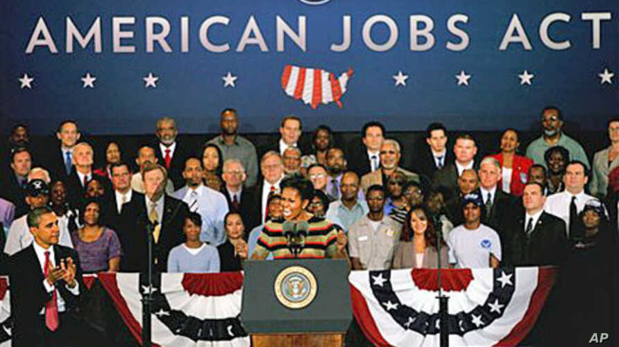 First lady Michelle Obama introduces her husband, President Barack Obama, while at a stop at Joint Base Langley-Eustis, in Hampton, Virginia, October 19, 2011.