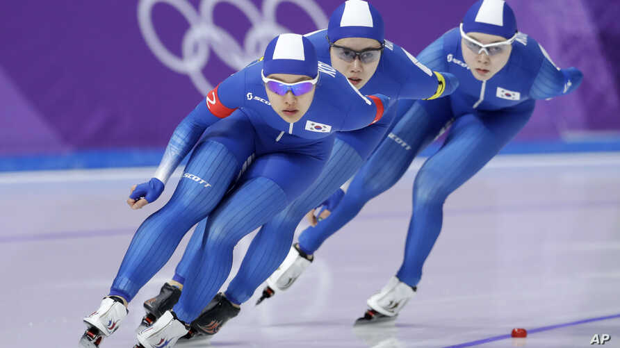 Team South Korea with Kim Bo-reum, front, Park Ji Woo, in second position, and Noh Seon-yeong, in last position, compete in the women's team pursuit speedskating race for seventh and eight place at the Gangneung Oval at the 2018 Winter Olympics in Ga