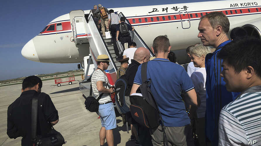 FILE - passengers board an Air Koryo plane bound for Beijing, at the Pyongyang International Airport in Pyongyang, North Korea.