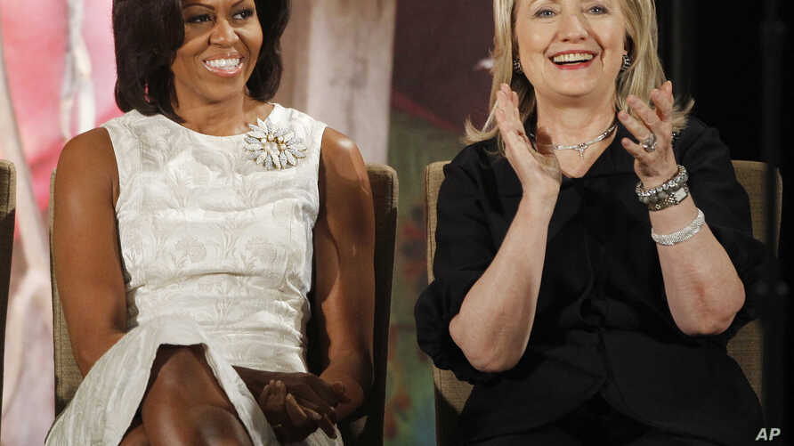 Clinton Obama The First Ladies: In this March 8, 2012, file photo, then-Secretary of State Hillary Clinton and first lady Michelle Obama attend the 2012 International Women of Courage Awards at the State Department in Washington. Clinton and Obama ar