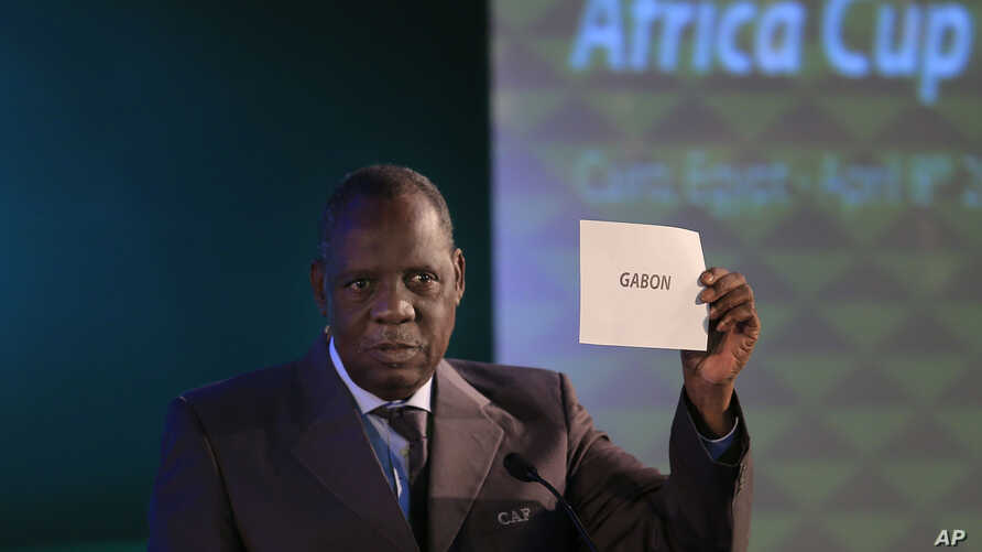 FILE - In this April 8, 2015 file photo, President of the Confederation of African Football, Issa Hayatou, announces that Gabon will be hosting the 2017 African Cup of Nations.