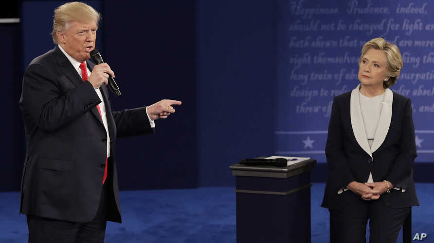 Republican presidential nominee Donald Trump speaks to Democratic presidential nominee Hillary Clinton during the second presidential debate at Washington University in St. Louis, Sunday, Oct. 9, 2016. (AP Photo/John Locher)