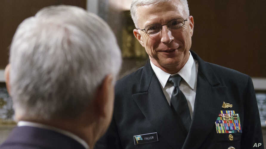 FILE - Navy Vice Adm. Craig Faller (R) talks with Senate Armed Services Committee ranking member Sen. Jack Reed, D-R.I., after a hearing on Capitol Hill in Washington.