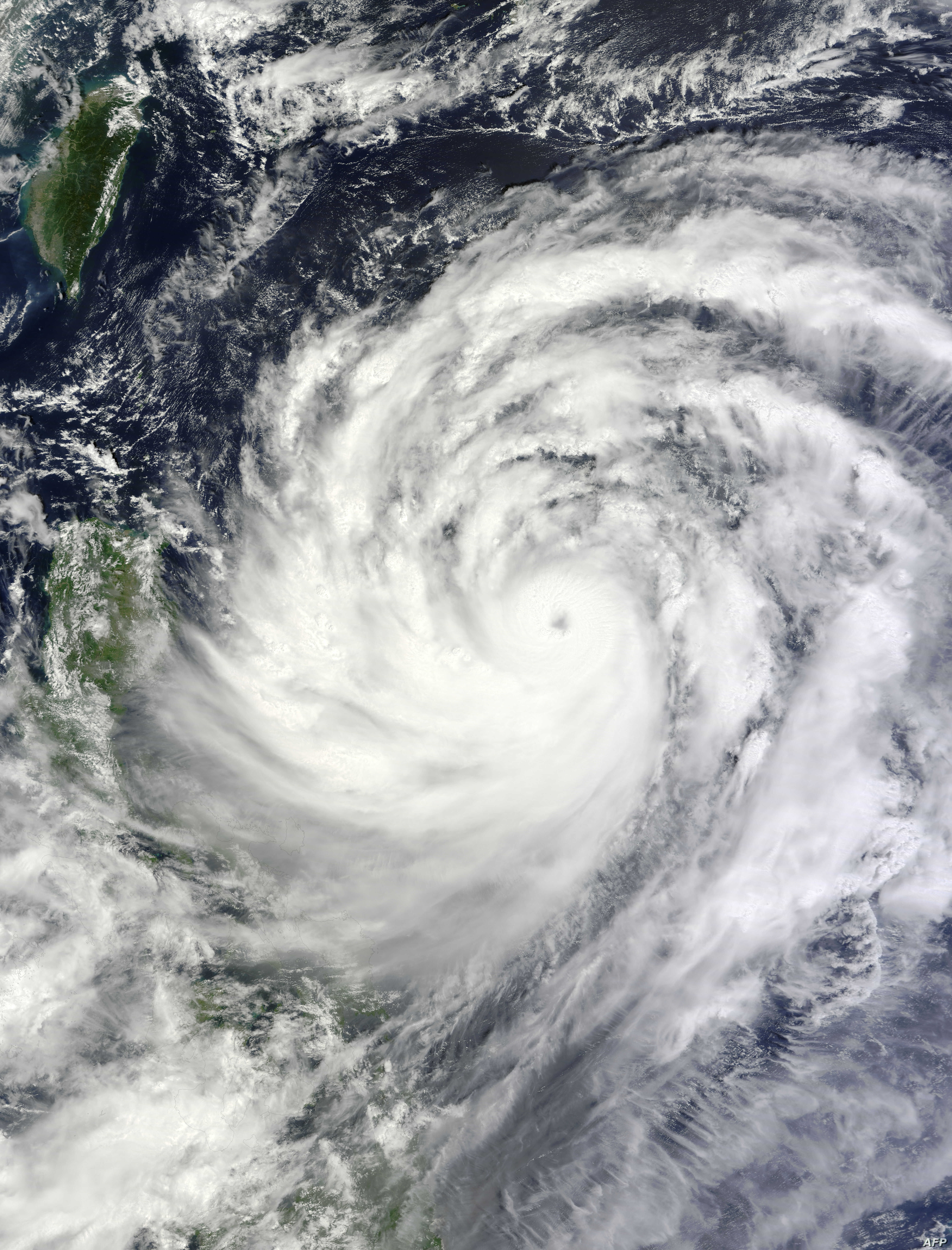 This NASA Terra satellite image obtained September 19, 2013 shows Typhoon Usagi nearing the Philippines and southern Taiwan. Taiwan's Central Weather Bureau said September 19, that Typhoon Usagi was about 900 kilometers (560 miles) southeast of Taiwa