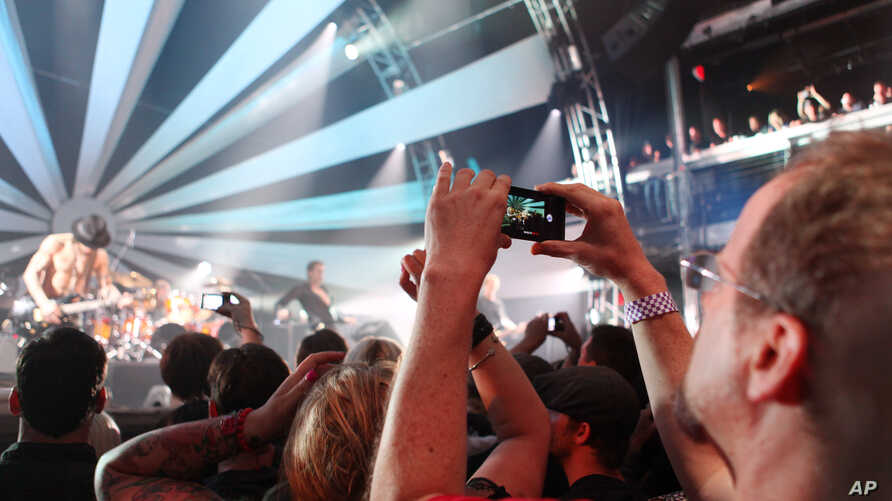 Mark Vopel records Jane's Addiction performance on the LG Thrill 4G, a glasses free 3D smartphone, at the 3D User-Generated Concert, July 25, 2011 in New York.