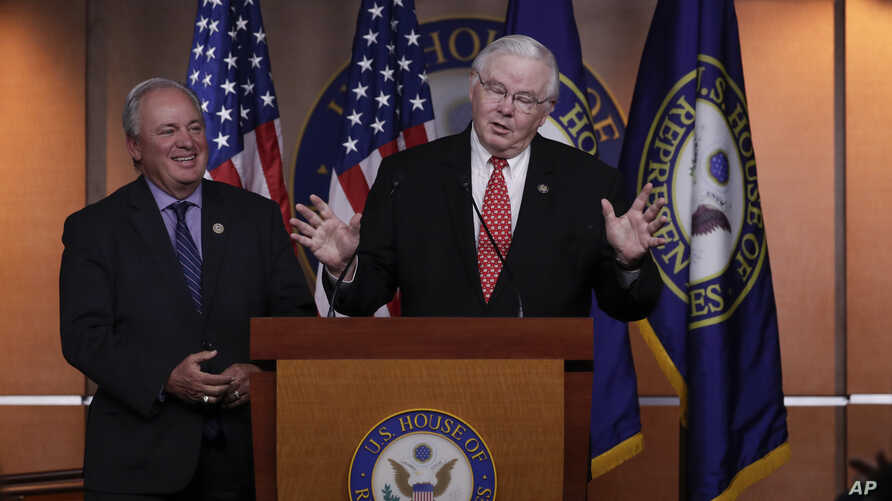 Republican team manager Rep. Joe Barton, R-Texas, right, accompanied by Democrat team manager Rep. Mike Doyle, D-Pa., speaks during a news conference on Capitol Hill in Washington, June 14, 2017.