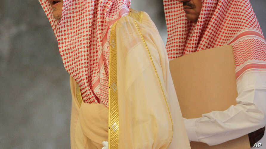 Saudi Foreign Minister Prince Saud Al Faisal, left, arrives with an unidentified aid for discussions with High Representative of the European Union Catherine Ashton and foreign ministers of EU and the other five Arab countries of the Gulf Cooperation