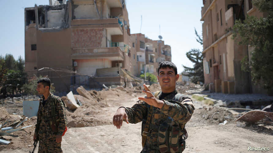 A Kurdish fighter from the People's Protection Units (YPG) is shown in Raqqa, Syria, June 27, 2017.