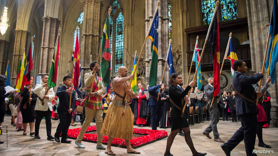 Flags of the Commonwealth being paraded through the Abbey at the Commonwealth Service at Westminster Abbey in London, March 12, 2018.