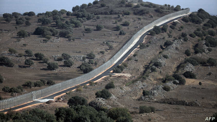 A picture taken from the Israeli-occupied Golan Heights on Aug. 30, 2014 shows the Israeli border with Syria near the Quneitra crossing, the only border crossing between Israel and Syria.