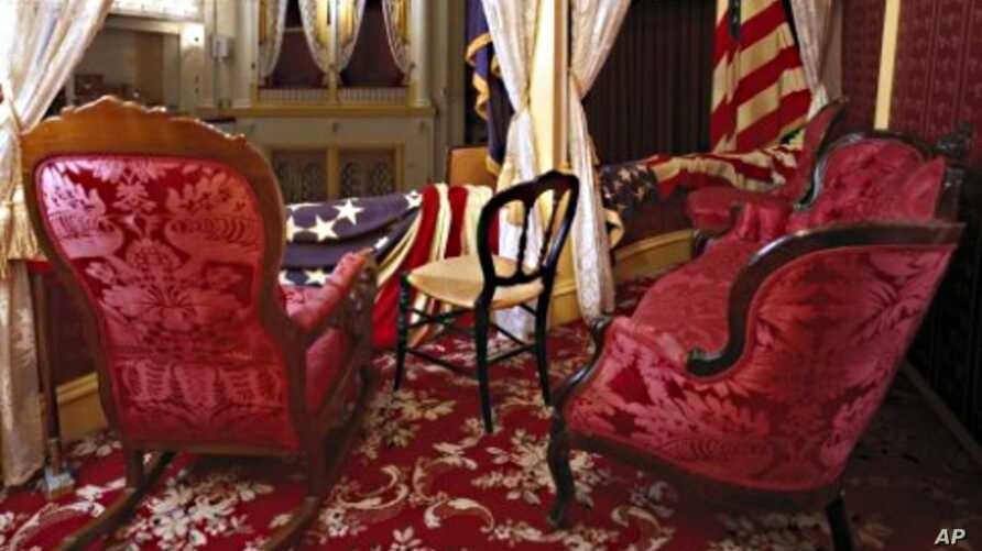 President Lincoln was sitting in a rocking chair, similar to this, in the presidential box at Ford's Theatre, now faithfully restored, when actor John Wilkes Booth snuck up behind him and shot him.