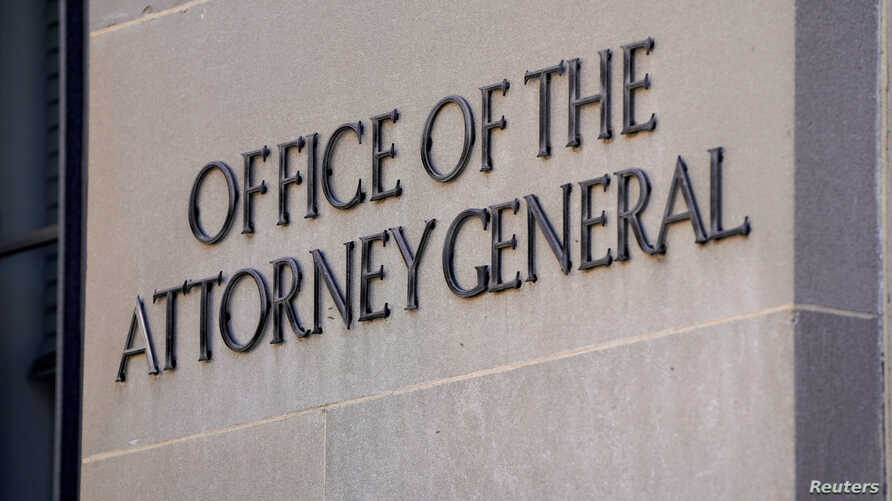 A sign of the Office of the Attorney General is displayed on the Department of Justice building the day after Special Counsel Robert Mueller delivered his report into Russia's role in the 2016 U.S. election and any potential wrongdoing by President D