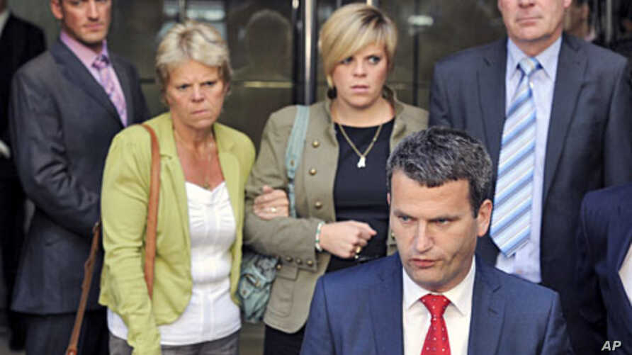 File photo shows the family of murdered teenager Milly Dowler (L-R), mother Sally Dowler, sister Gemma and father Bob standing behind their lawyer Mark Lewis after meeting Rupert Murdoch at a hotel in central London, July 15, 2011