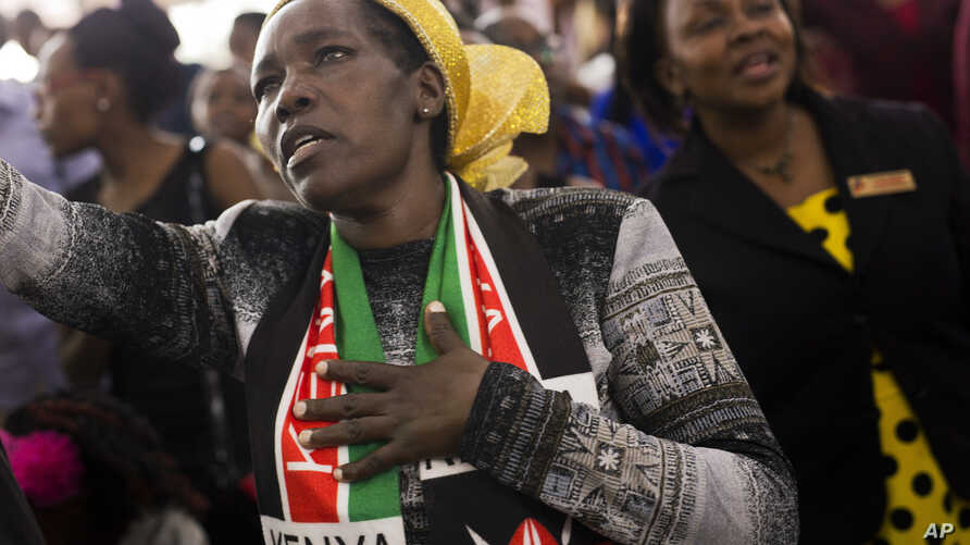 Kenyans participate in Sunday church service with President Uhuru Kenyatta present in Nairobi, Aug. 6, 2017.