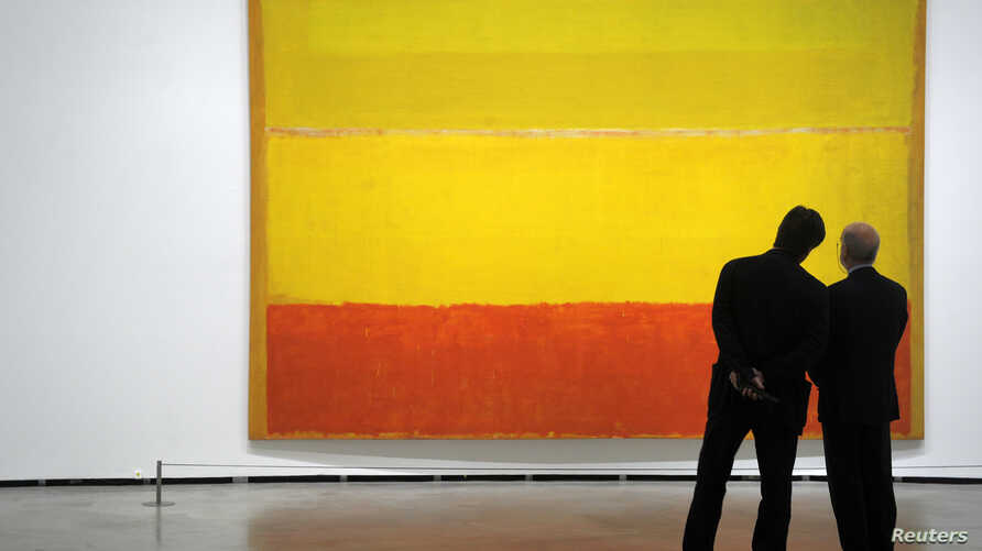 """Visitors observe """"Untitled"""", a 1952-3 painting by U.S. artist Mark Rothko during the opening of """"Pictorial Abstraction. European and American Art Tendencies 1949-1969"""" at the Guggenheim Museum in Bilbao June 14, 2011. The exhibition, featuring eighty"""