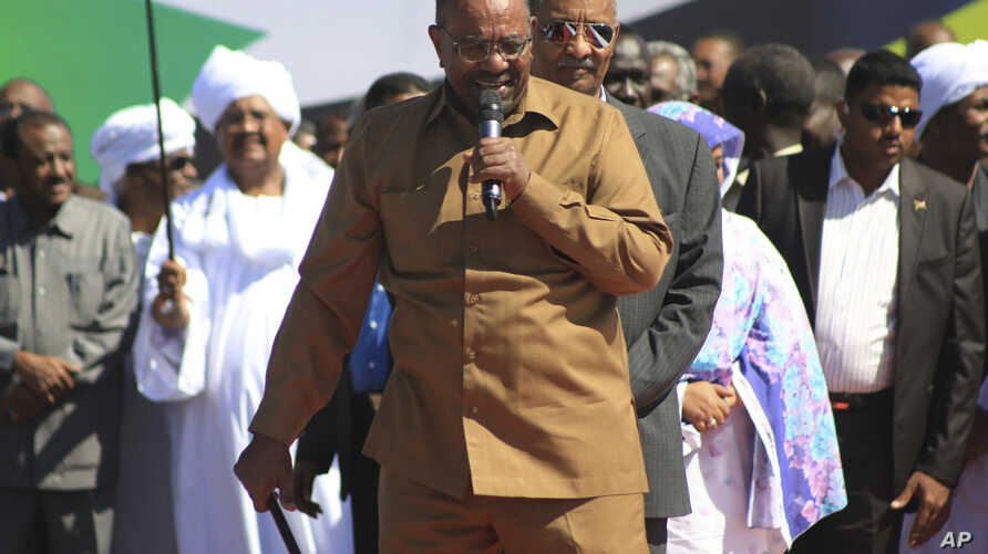 FILE - Sudan's President Omar al-Bashir addresses supporters at a rally in Khartoum, Sudan, Jan. 9, 2019.