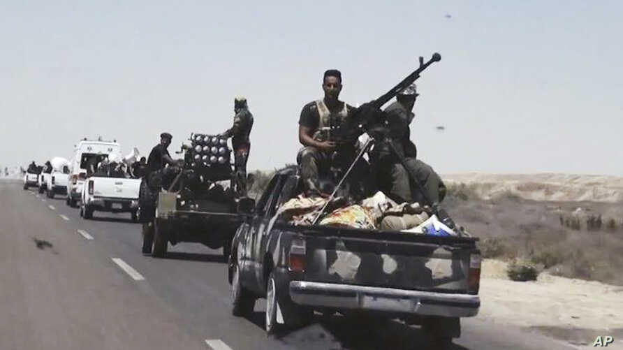 FILE - Iraqi security forces backed by Shiite and Sunni pro-government fighters prepare to attack Islamic State group positions in Fallujah, 40 miles (65 kilometers) west of Baghdad, Iraq, Monday, July 13, 2015.