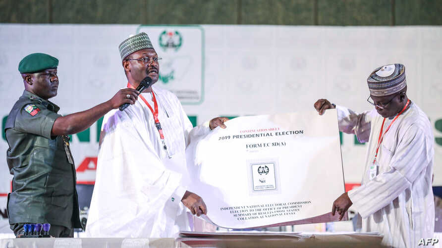Nigeria's Independent National Electoral Commission (INEC) chairman Mahmood Yakubu displays vote result sheets on Feb. 25, 2019 in Abuja