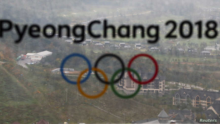 FILE - The PyeongChang 2018 Winter Olympic Games logo is seen at the the Alpensia Ski Jumping Center in Pyeongchang, South Korea, Sept. 27, 2017.