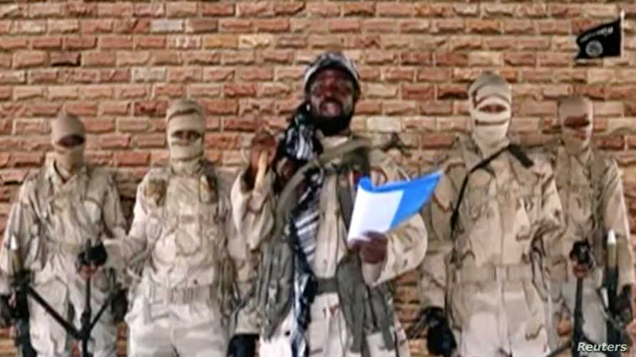 Leader of one of the Boko Haram group's factions, Abubakar Shekau speaks in front of guards in an unknown location in Nigeria in this still image taken from an undated video obtained on Jan. 15, 2018.