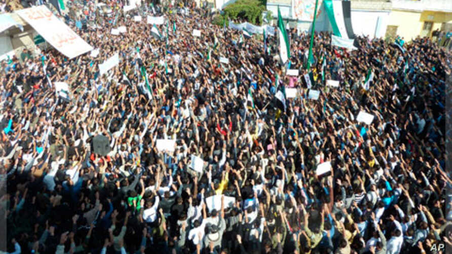 Demonstrators protest against Syria's President Bashar al-Assad gather in Hula, near Homs, November 13, 2011.