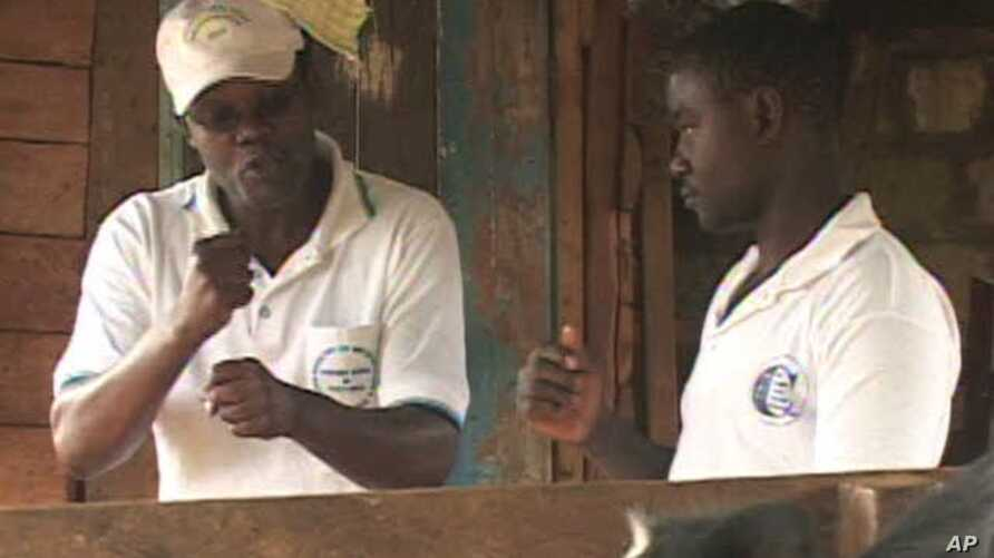 Joseph Shiroko, founder of Brian Resource Center, communicates with a student in sign language